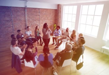 people sitting in a group therapy